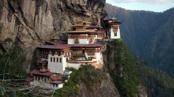 Paro Taktsang dzong 359x201 - Carmen - Lady in red -