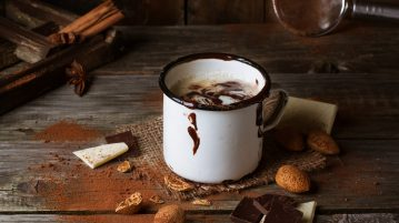 mug-hot-chocolate-served-chunks-white-and-dark-chocolate-and-almonds-old-wooden-table_0