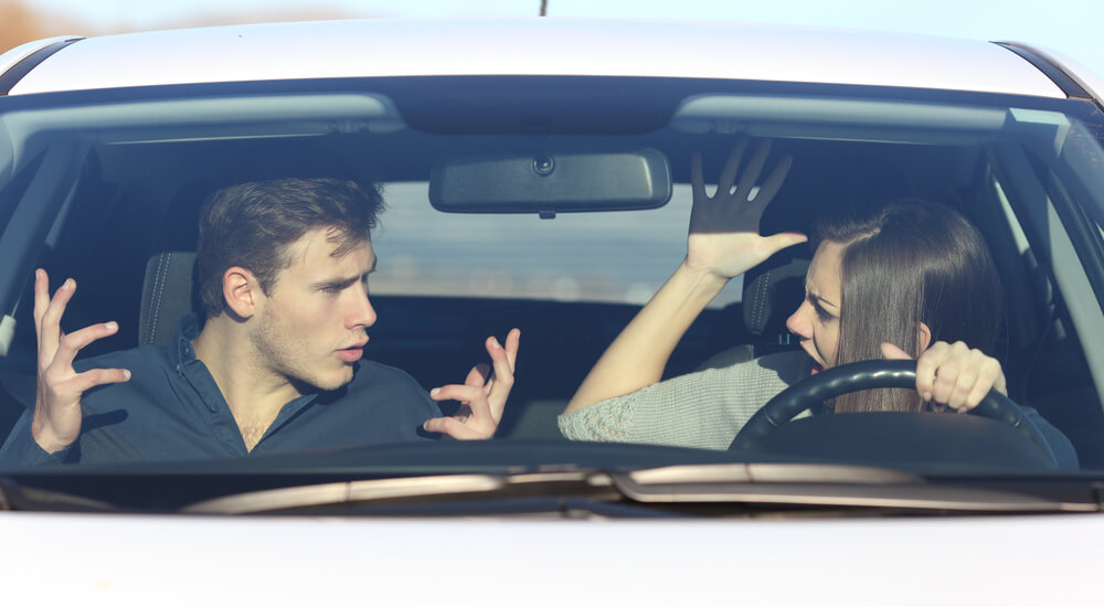 couple-fighting-in-a-car